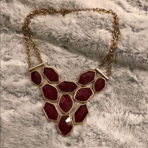 Gold necklace with garnet stones